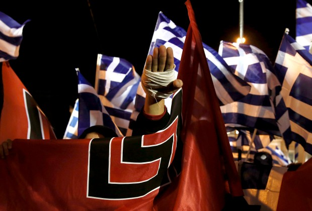 A supporter of Greece's far-right Golden Dawn party salutes in a Nazi style during a rally at central Syntagma square in Athens